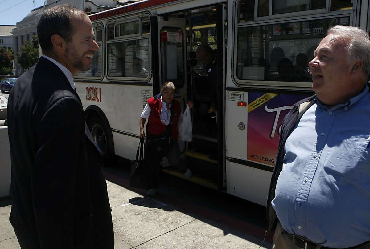 Ed Reiskin is congratulated by a pedestrian on his appointment to the executive director of Municipal Transportation Agency position in San Francisco Calif., on July 21, 2011.