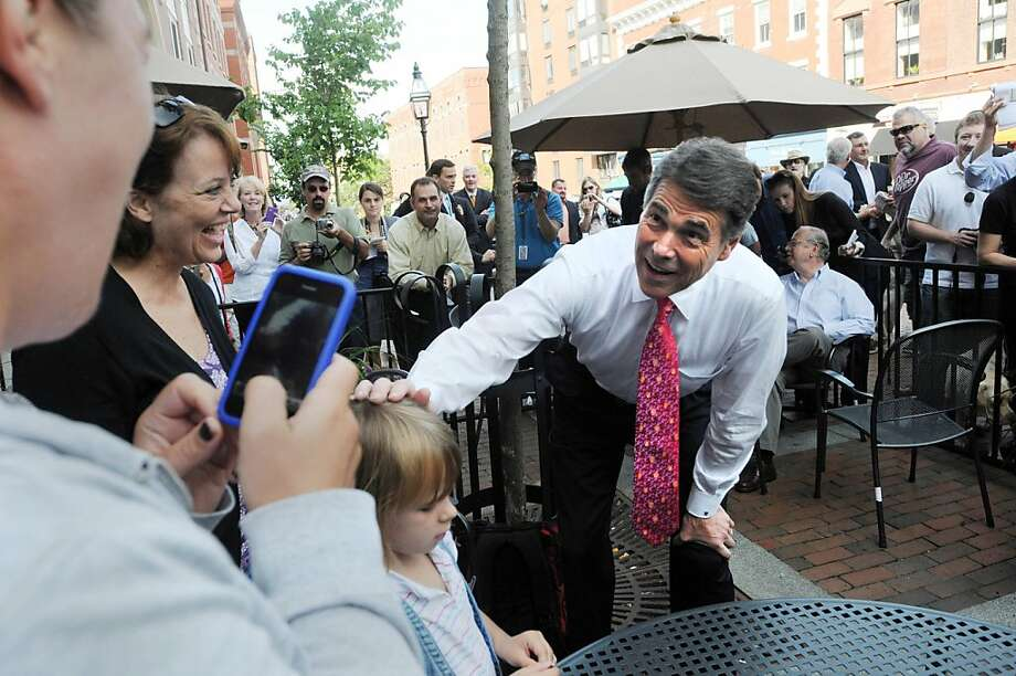 PORTSMOUTH, NH - AUGUST 18: Republican presidential candidate and Texas Governor Rick Perry speaks with eaters at Popovers on the Square August 18, 2011 in Portsmouth, New Hampshire. Perry has been campaigning since he declared his candidacy for the Republican nomination on August 13.  (Photo by Darren McCollester/Getty Images)  *** BESTPIX *** Photo: Darren McCollester, Getty Images