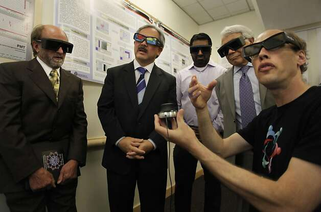 (left to right) Thomas Ferrin, professor of Pharmacutical Chemistry, Mayor Ed Lee, Kishore Hari, director of the Bay Area Science Fesitval and Keith Yamamoto, UCSF vice chancellor, on Tuesday August 16, 2011, in San Francisco, Ca., are given a 3-D visualization of a HIV molecule by UCSF programmer, Tom Goddard, as local officials promote the upcoming Bay Area Science Festival. Photo: Michael Macor, The Chronicle