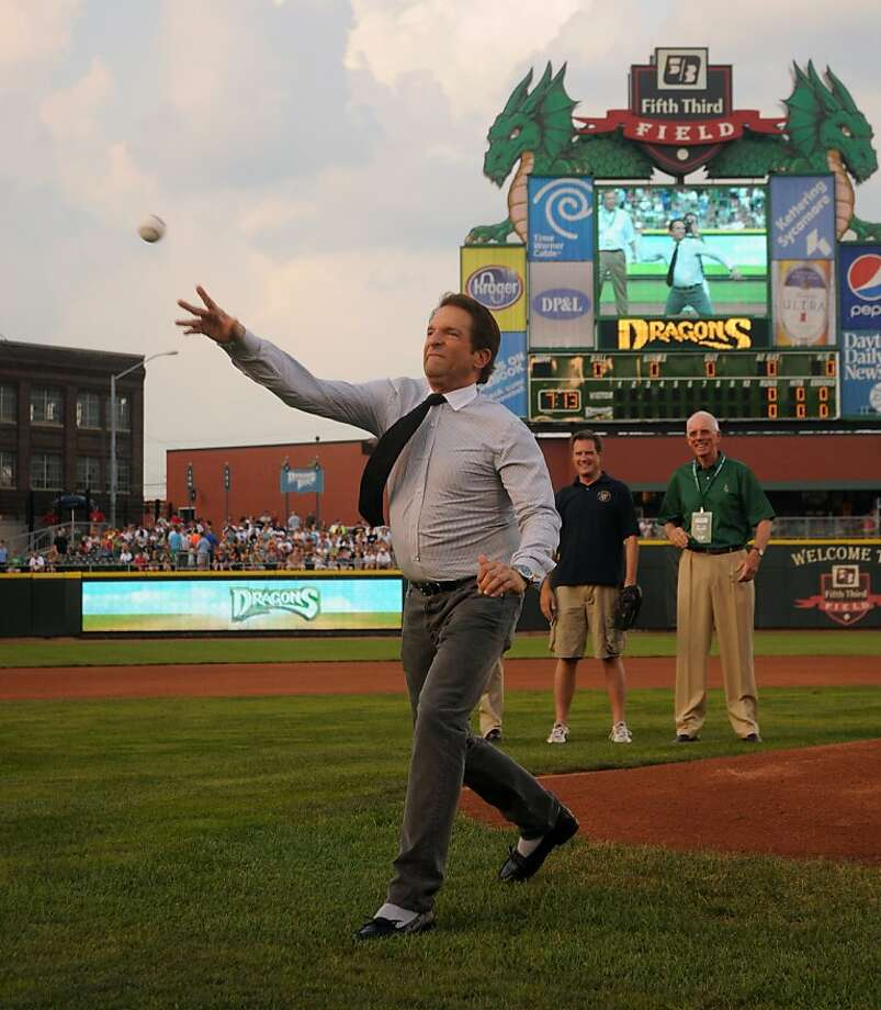 Peter Guber throws out the first pitch in a game for the Dayton Dragons, a Class A minor-league baseball team in the Cincinnati Reds' farm system. Guber is a co-owner of Dragons, as well as the the Golden State Warriors in the NBA. This pitch came before the team's 815th consecutive home sellout, on July 9, 2011, at Fifth Third Field in Dayton, Ohio. Photo: Courtesy Dayton Dragons