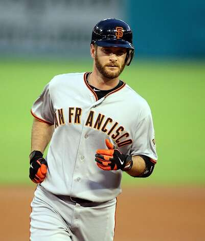 MIAMI GARDENS, FL - AUGUST 13:  Jeff Keppinger #8 of the San Francisco Giants hits a home run against the Florida Marlins at Sun Life Stadium on August 13, 2011 in Miami Gardens, Florida.  (Photo by Marc Serota/Getty Images) Photo: Marc Serota, Getty Images