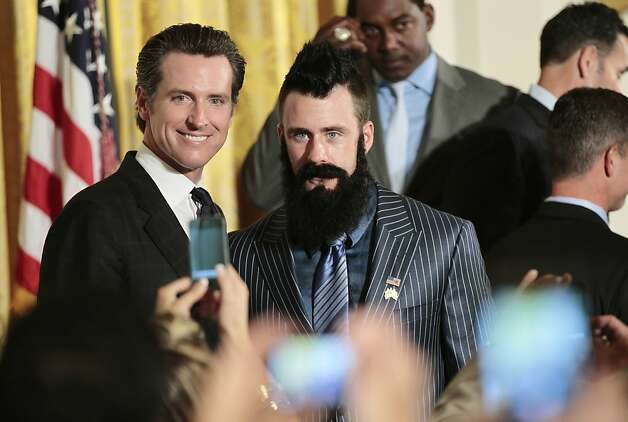 San Francisco Giants baseball pitcher pitcher Brian Wilson, right, California Lt. Gov., and former San Francisco Mayor, Gavin Newsom, left, pose for photos in the East Room of the White House in Washington, Monday, July 25, 2011, during a ceremony honoring the 2010 World Series baseball champions. (AP Photo/Pablo Martinez Monsivais  Ran on: 07-26-2011 Lt. Gov. Gavin Newsom, seen with Giants reliever Brian Wilson, was in Washington for meetings anyway, his staff said. Photo: Pablo Martinez Monsivais, Associated Press