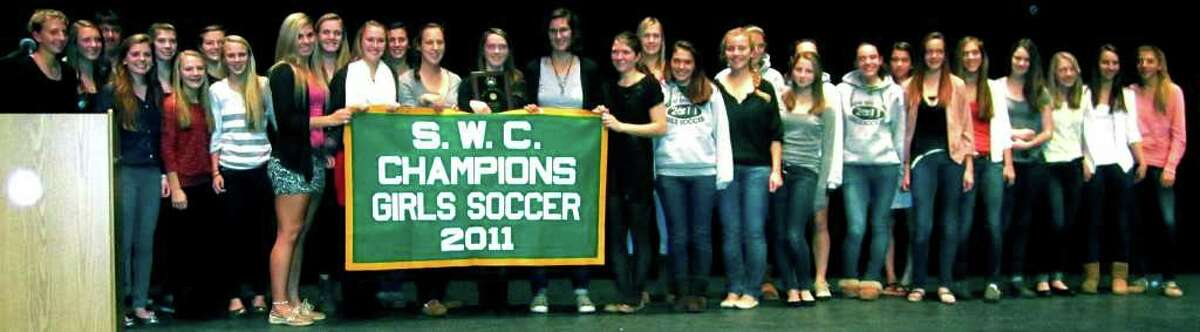 SPECTRUM/The Green Wave girls' soccer side shows off the school's first league championship banner in either boys' or girls' soccer. Nov. 28, 2011 .