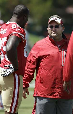San Francisco 49ers tight end Verdon Davis, left, talks with offensive coordinator Greg Roman during NFL football training camp in Santa Clara, Calif., Friday, July 29, 2011. (AP Photo/Jeff Chiu) Photo: Jeff Chiu, AP