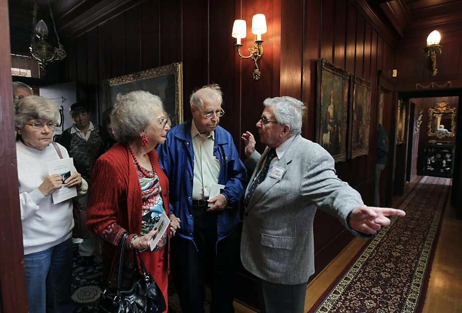 Lee Forster (right), portraying the ghost of Sam Mazza, greets guests attending a public tour of the historic Sam's Castle in Pacifica, Calif. on Friday, August 12, 2011. Originally built in 1908 by the grandfather of congressman Pete McCloskey, the ornate home became known as Sam's Castle after the eccentric Sam Mazza bought the home in 1959 for $29,000. Photo: Paul Chinn, The Chronicle