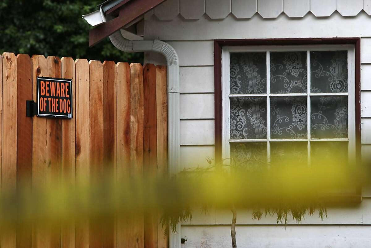 A Beware of the Dog sign is seen on the fence at the home where Darla Napora, 32, was mauled and killed by a family pit bull Thursday on Friday, August 12, 2011 in Pacifica, Calif.