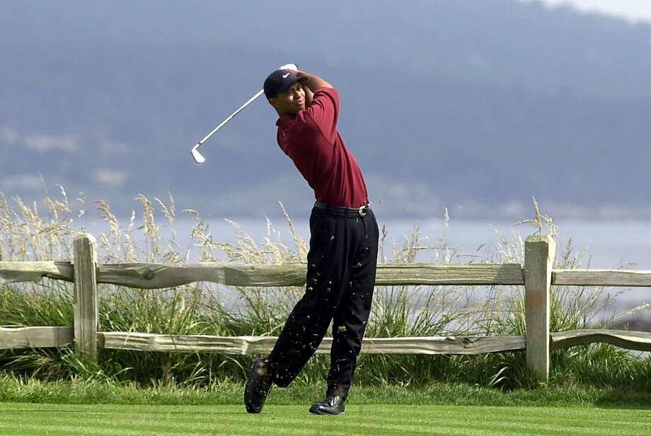 Tiger Woods drives the 18th hole on his way to winning the 100th U.S. Open Golf Championship at the Pebble Beach Golf Links in Pebble Beach, Calif., Sunday, June 18, 2000. Woods finished at 12-under 272, 15 strokes ahead his nearest competitor. (AP Photo/Elise Amendola)  Ran on: 06-13-2010 Ten years ago, Tiger Woods was in otherworldly form on the 72nd hole of the U.S. Open. He returns to Pebble Beach with questions surrounding his game. Photo: Elise Amendola, AP 2000