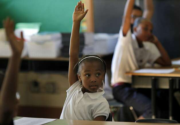 Fifth grader Solara Ross raised her hand to answer a question in Steve Tamsky's class.  Reading scores doubled for African American students at Muir. At John Muir Elementary School in San Francisco, Calif. it was the first day of school for 2011. Photo: Brant Ward, The Chronicle