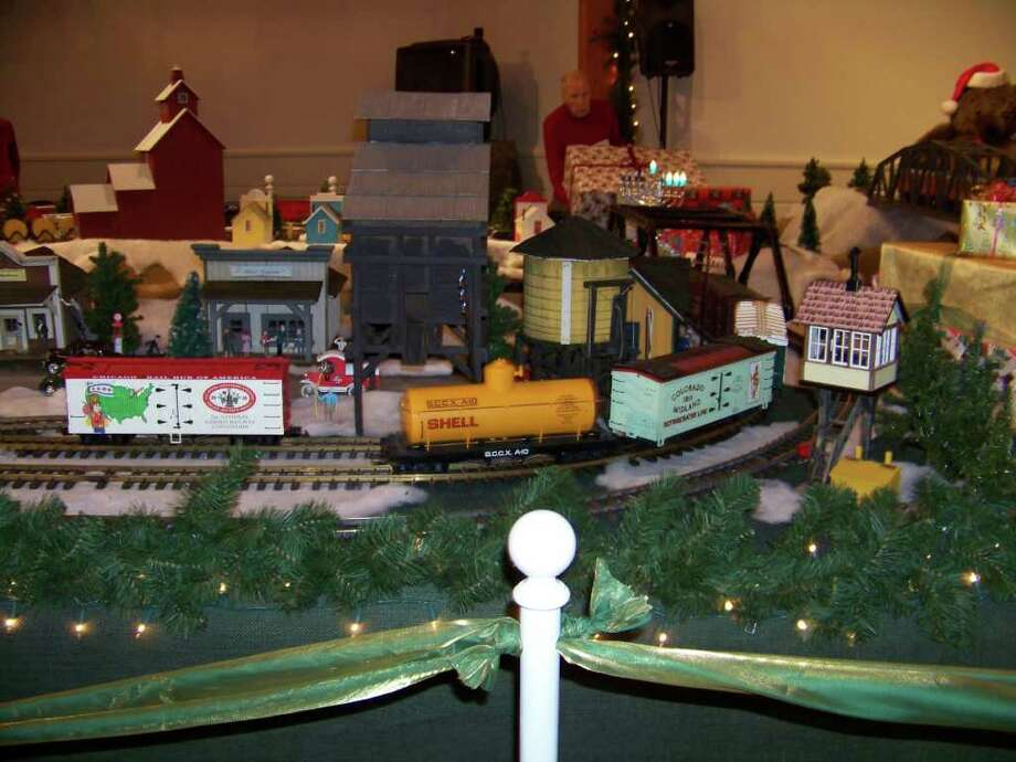 Model box cars and a tanker car whiz along the tracks past structures at last year's Holiday Express Train Show at the Fairfield Museum and History Center. This year's show open Friday, Dec. 2, and continues throough the end of the year. Photo: Contributed Photo / Fairfield Citizen contributed