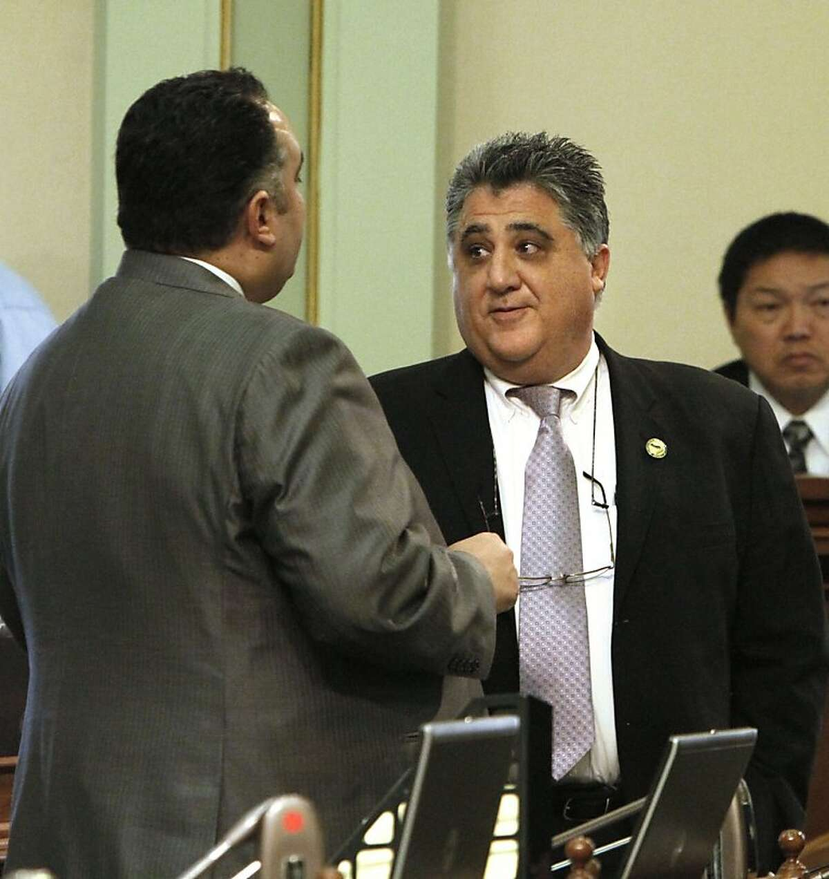 In this photo taken March 16, 2011, Assemblyman Anthony Portantino, D- La Canada Flintridge, right, talks with Assembly Speaker John Perez, D-Los Angeles, during a debate over the state budget at the Capitol in Sacramento. Portantino said his bill to push back school start times at middle and high schools in the state is dead for the year after intense lobbying against the measure in recent days.