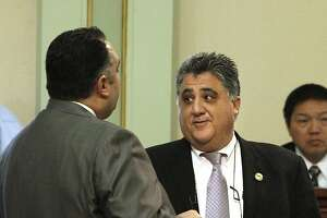 In this photo taken March 16, 2011, Assemblyman Anthony Portantino, D- La Canada Flintridge, right, talks with Assembly Speaker John Perez, D-Los Angeles, during a debate over the state budget at the Capitol in Sacramento, Calif. Portantino was notified, Monday, Aug. 1, 2011, that his  request  for details of his own current office budget was refused by the Assembly Rules Committee.  The rejection comes a few days after members of his Capitol and Pasadena district office staff started receiving notices that  they will be furloughed for 40 days because of claims by the rules committee that Portantino has overspent.  Portantino says he is being  punished for failing to vote for the state budget last month.(AP Photo/Rich Pedroncelli)