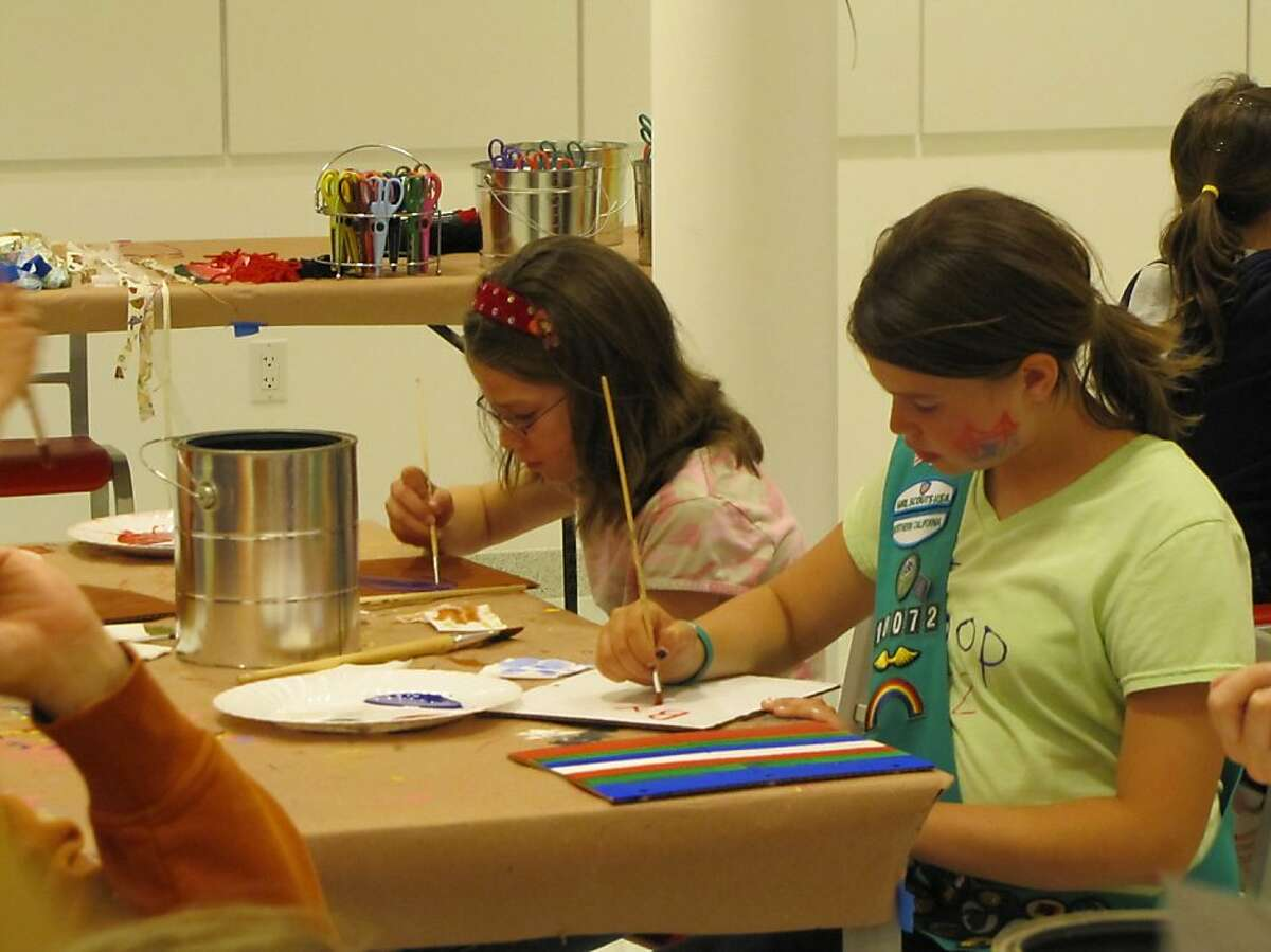 Two young guests create and paint Peter Pan Adventure Diaries at May's Disney Discoveries Workshop at the Walt Disney Family Museum.
