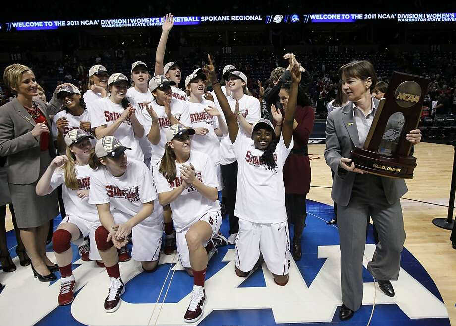 Stanford players cheer as coach Tara VanDerveer, right, holds the championship trophy after beating Gonzaga in an NCAA women's college basketball tournament regional final, Monday, March 28, 2011, in Spokane, Wash. Stanford won 83-60. (AP Photo/Elaine Thompson)  Ran on: 03-29-2011 Tara VanDerveer holds the trophy after Stanford reached another Final Four. Ran on: 03-29-2011 Tara VanDerveer holds the trophy after Stanford reached another Final Four. Photo: Elaine Thompson, AP