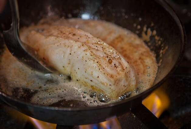 The Roasted Halibut being cooked in the kitchen at Bluestem. Photo: John Storey, Special To The Chronicle