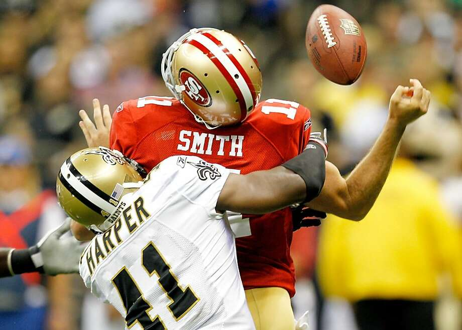 NEW ORLEANS, LA - AUGUST 12:  Alex Smith #11 of the San Francisco 49ers is hit by Roman Harper #41 of the New Orleans Saints during a preseason game at Louisiana Superdome on August 12, 2011 in New Orleans, Louisiana. Photo: Sean Gardner, Getty Images