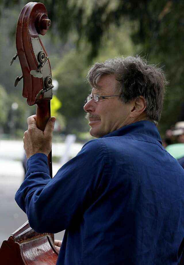 Paul Henry Tieck brings his bass out to accompany the swing music when he can. The 15th anniversary of Lindy in the Park, an event in San Francisco's Golden Gate Park that started as an impromptu swing dance lesson, was held Sunday August 14, 2011. Photo: Brant Ward, The Chronicle