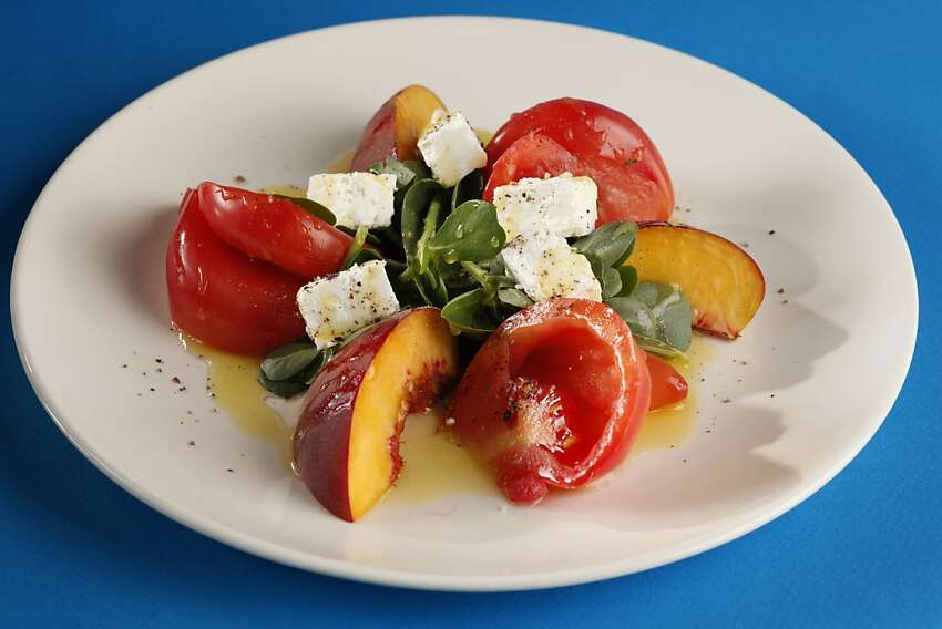 Heirloom Tomato Salad With Peaches: Summer in a bowl. Click here for the recipe.