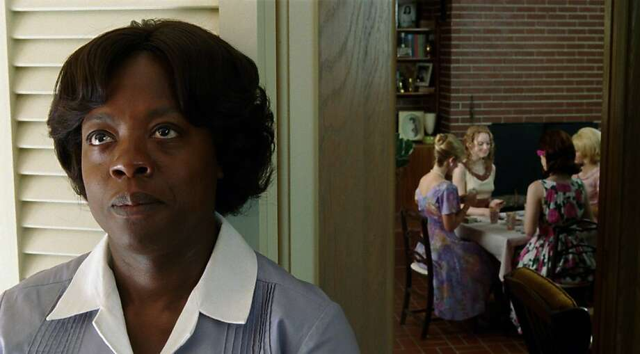 """THE HELP""  FF-001  Aibileen Clark (Viola Davis) overhears the exchange between Skeeter Phelan (Emma Stone, center) and her friends in DreamWorks Pictures' drama, ""The Help"", based on the New York Times best-selling novel by Kathryn Stockett.  ©DreamWorks II Distribution Co., LLC.  All Rights Reserved."
