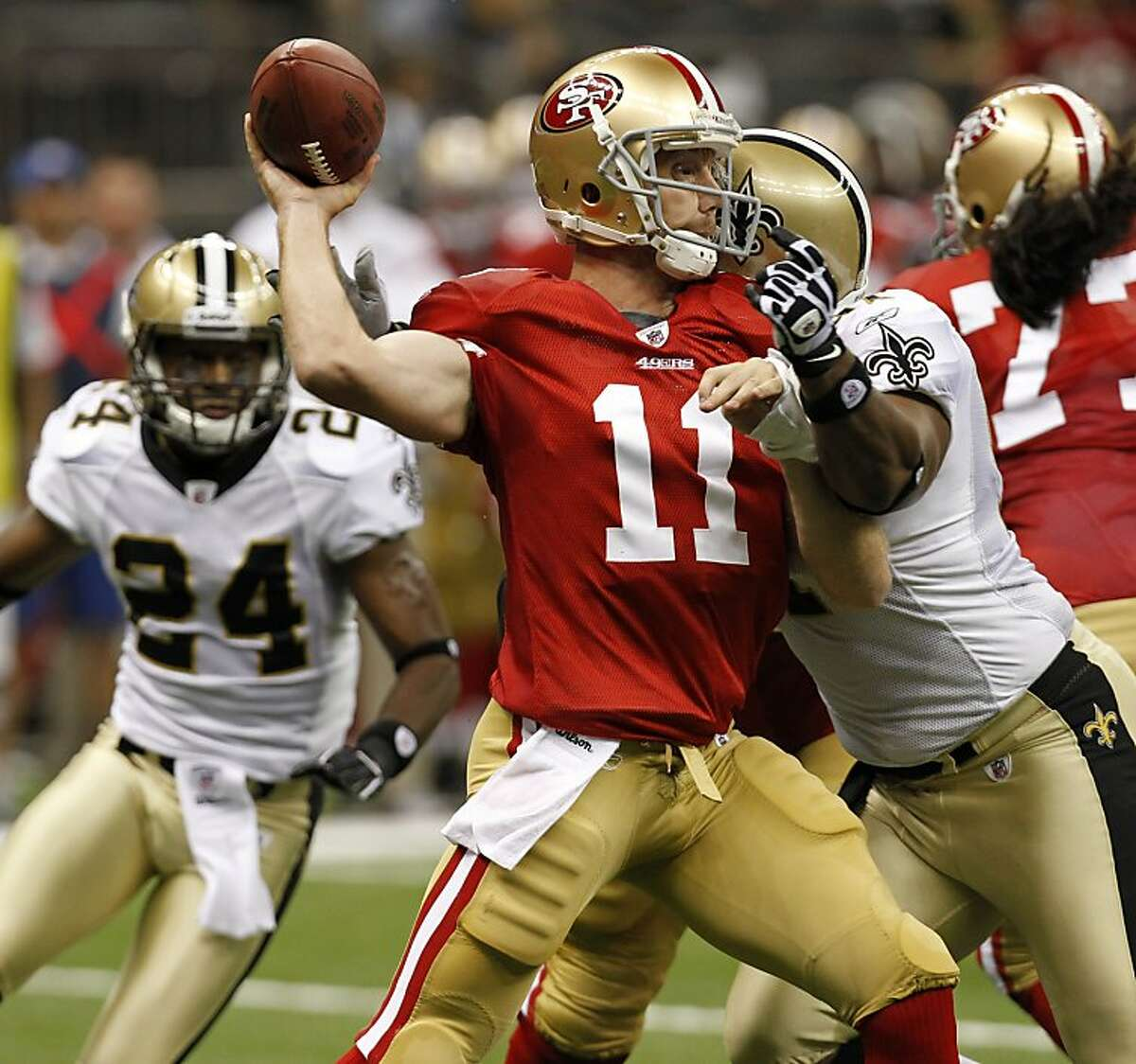 San Francisco 49ers quarterback Alex Smith (11) is hit by New Orleans Saints defensive end Will Smith (91) during the first quarter of an NFL football game at the Louisiana Superdome in New Orleans, Friday, Aug. 12, 2011. (AP Photo/Gerald Herbert)