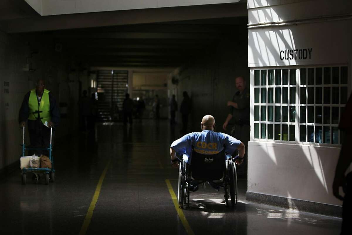 An inmate passes through a corridor at the California Medical Center at California Medical Facility on Thursday, August 4, 2011 in Vacaville, Calif.