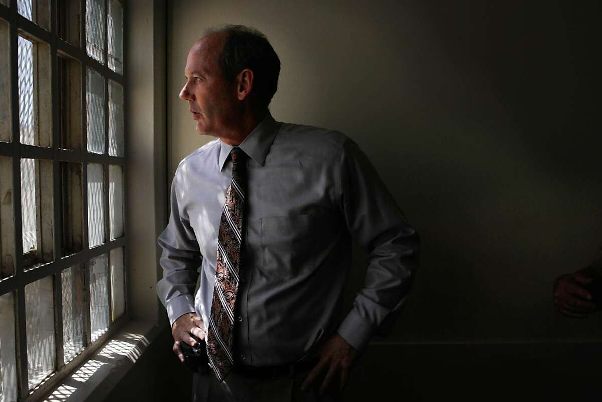 David Silbaugh, California Medical Facility Chief Psychologist looks out a window in Unit 1 at California Medical Center at California Medical Facility on Thursday, August 4, 2011 in Vacaville, Calif.
