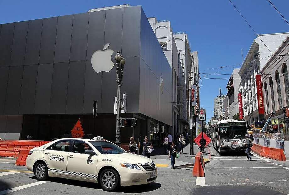 SAN FRANCISCO, CA - JULY 19:  A car drives by an Apple Store on July 19, 2011 in San Francisco, California.  Apple Inc. beat Wall Street expectations with a third quarter net profit of $7.31 billion, or $7.79 per share, compared to $3.25 billion, or $3.51 per share one year ago.  (Photo by Justin Sullivan/Getty Images)  Ran on: 07-20-2011 &quo;We're thrilled to deliver our best quarter ever,&quo; Apple CEO Steve Jobs said in a statement following the announcement of record earnings. Photo: Justin Sullivan, Getty Images
