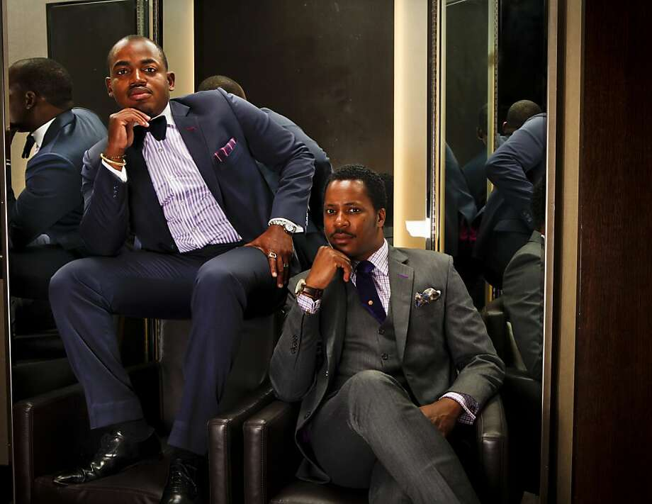 Jerry Folly-Kossi and Gilbert Emile of Swell Attitude a custom menswear and image consulting company are seen in a fitting room at Bloomingdale's in San Francisco, Calif., on Tuesday, July 19, 2011. Photo: Russell Yip, The Chronicle