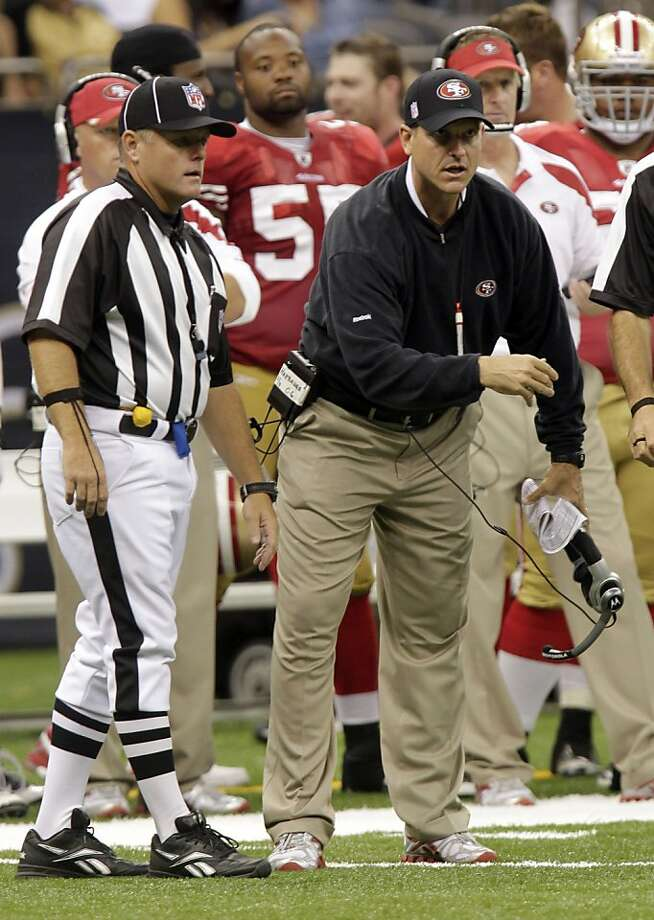 San Francisco 49ers head coach Jim Harbaugh gestures from the sideline during an NFL preseason football game against the New Orleans Saints at the Louisiana Superdome in New Orleans, Friday, Aug. 12, 2011. (AP Photo/Bill Haber) Photo: Bill Haber, AP