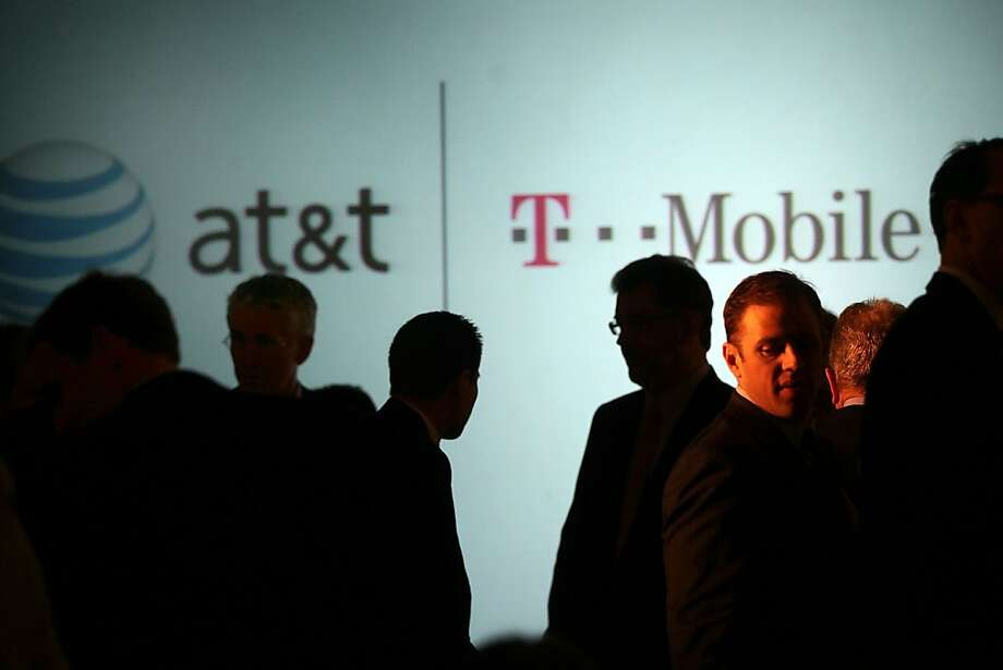 NEW YORK, NY - MARCH 21:  Executives at AT&T attend a news conference where it was announced that AT&T Inc. will be buying its wireless rival T-Mobile USA from Deutsche Telekom AG for $39 billion in cash and stock on March 21, 2011 in New York City. The deal, which will be scrutinized by U.S. regulators, would create the nation's largest wireless carrier if approved. The deal would likely result in domestic job cuts. T-Mobile USA employs about 38,000 people while AT&T employs an estimated 267,000 people. Photo: Spencer Platt, Getty Images