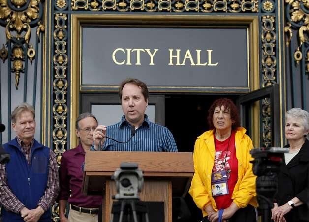 Jon Golinger, center, president of the Telegraph Hill dwellers association, is concerned about the effects on his neighborhood and the bay. A variety of civic and environmental groups in San Francisco, Calif., are concerned about pollution and debris in the bay during the upcoming America's Cup. Photo: Brant Ward, The Chronicle