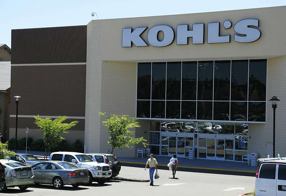 In this Aug. 8, 2011 photo, shoppers enter and exit the Kohl's store in San Rafael, Calif. Kohl's Corp. is reporting that its second-quarter profits rose 17 percent Thursday, Aug. 11, as the mid-brow department store chain's expense controls and success in its store-label brands offset modest revenue growth. The company says it's increasing its profit guidance.  (AP Photo/Eric Risberg) Photo: Eric Risberg, AP