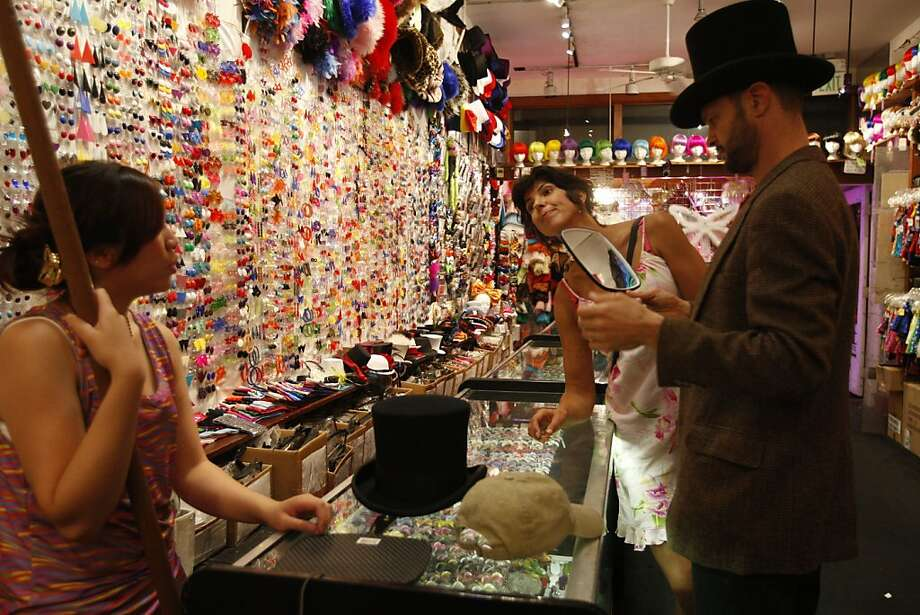 Employee Zerelle Tamayo (left) helps Djoke Steen (center) and Rich Shinne find the right Halloween accessory at Piedmont Boutique in San Francisco, Cailf., on Oct. 14, 2010. Photo: Michelle Gachet, The Chronicle 2010