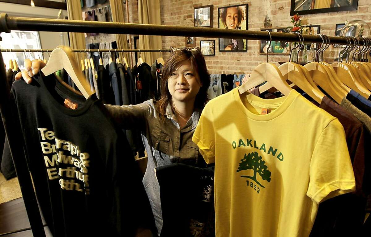 Owner, Angela Tsay at the new home of Oaklandish on Tuesday August 2, 2011, in Oakland, Ca. Oaklandish starting selling their love of Oakland at local farmer's markets but now they have opened a new retail store near the corner of Broadway and 14th street.