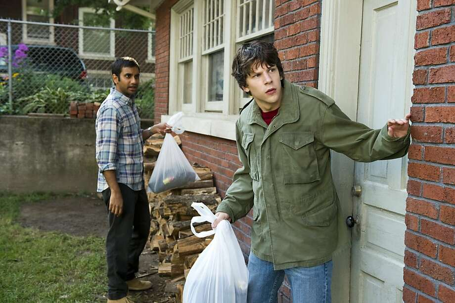 "Aziz Ansari, left, and Jesse Eisenberg in Columbia Pictures' ""30 Minutes or Less."" Photo:   Wilson Webb, Columbia Tristar"