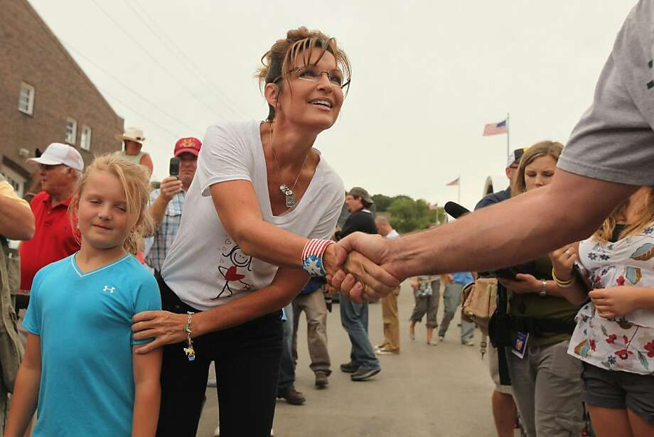 DES MOINES, IA - AUGUST 12:  Former Alaska Governor Sarah Palin shakes hands with fairgoers while visiting the Iowa State Fair August 12, 2011 in Des Moines, Iowa. Although she has not announced any intention of running for president, all of the Republican presidential hopefuls are visiting the fair ahead of Saturday's Iowa Straw Poll to greet voters and engage in traditional Iowa campaigning rituals.  (Photo by Chip Somodevilla/Getty Images) Photo: Chip Somodevilla, Getty Images