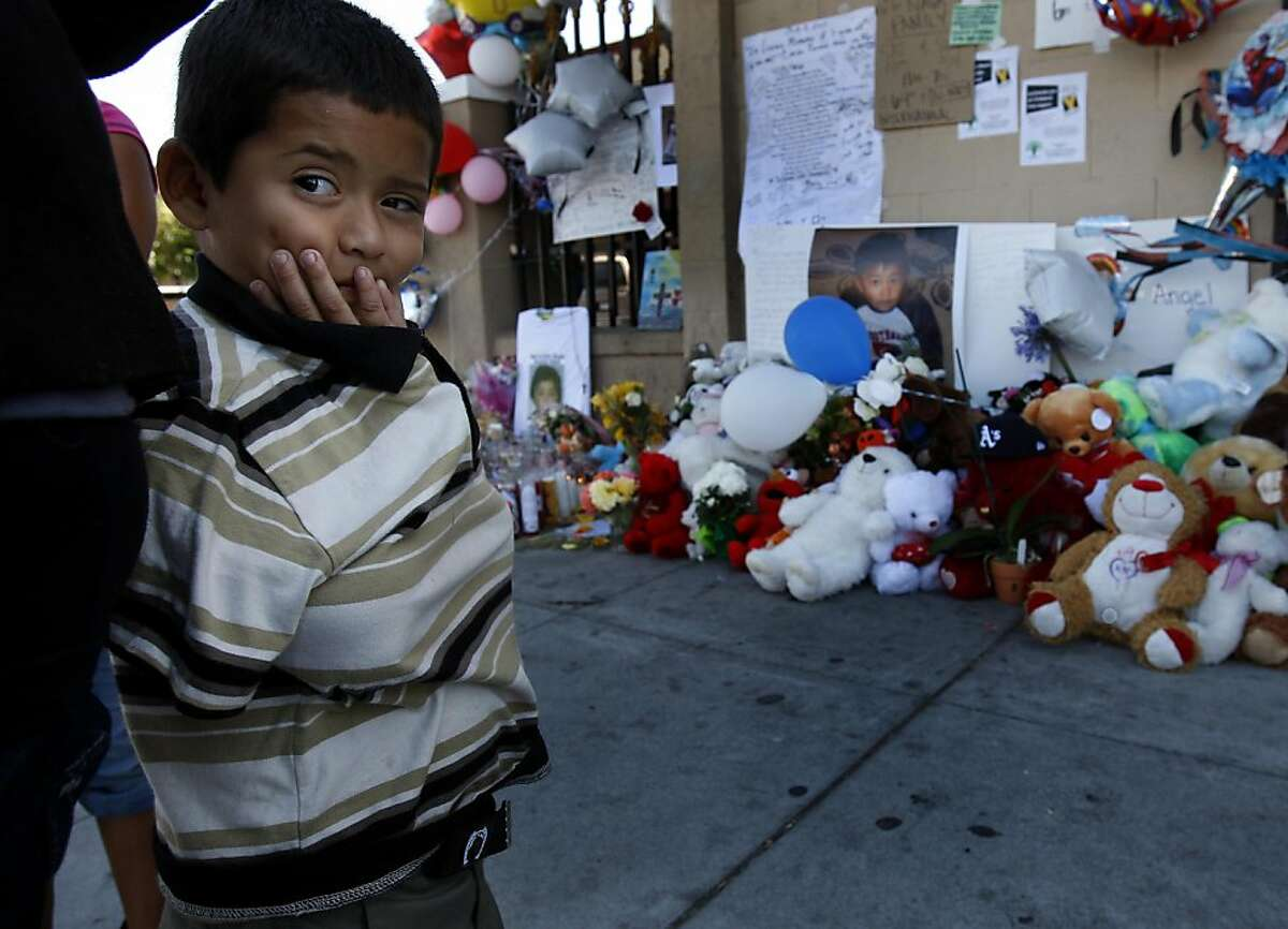 Jonathan Cruz, who used to play with Carlos Nava, visited the memorial on International Blvd. in Oakland, Calif. People who live near 64th Avenue and International, where little Carlos Nava was gunned down, were still reeling from the tragedy Wednesday August 10, 2011.