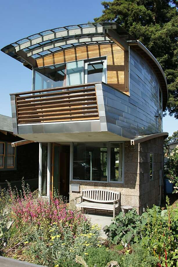 The two-bedroom McGee House by Leger Wanaselja Architecture features salvaged and upcycled item. The upper walls are clad with metal from over 100 car roofs. Awnings are made from old Dadge Caravan windows; the lower story is clad with poplar bark, leftover from furniture manufacturing. Photo: Leger Wanaselja