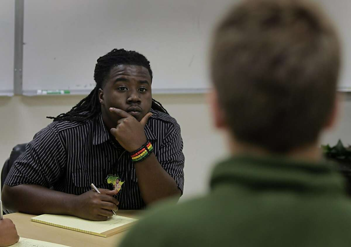 Rashid Campbell, a mentor at a debate camp sponsored by the Bay Area Urban Debate League in Oakland, Calif. on Friday, August 5, 2011, judges a debate competition at the camp.