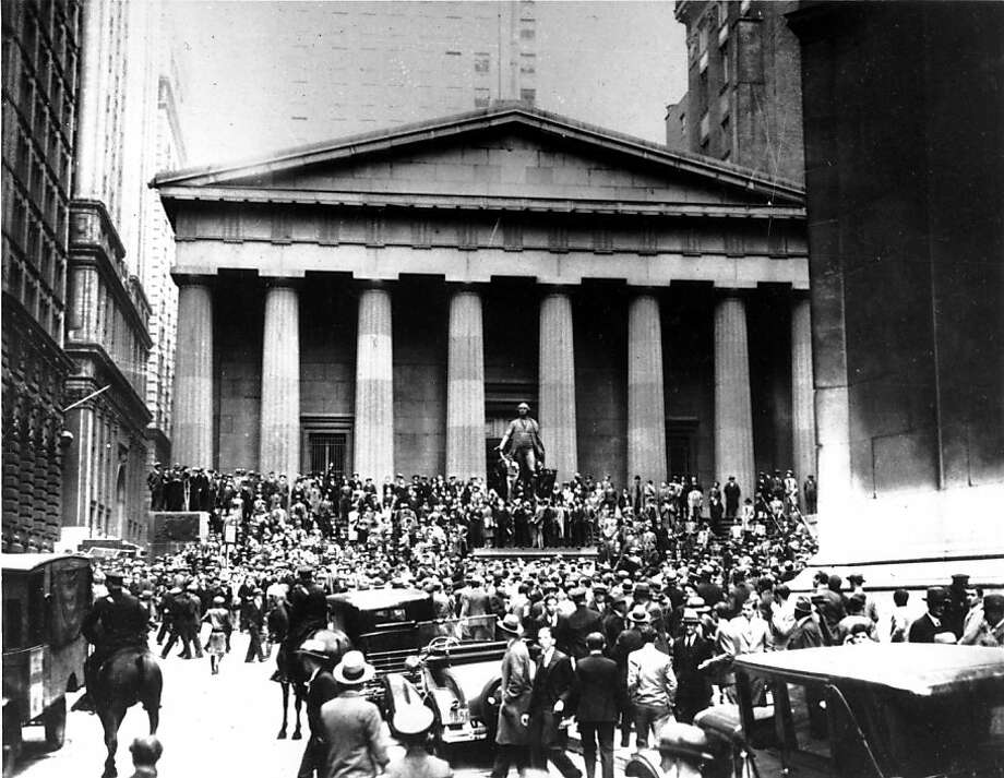 **FILE** Crowds panic in the Wall Street district of Manhattan due to the heavy trading on the stock market in New York City on Oct. 24, 1929.  (AP Photo) Photo: AP