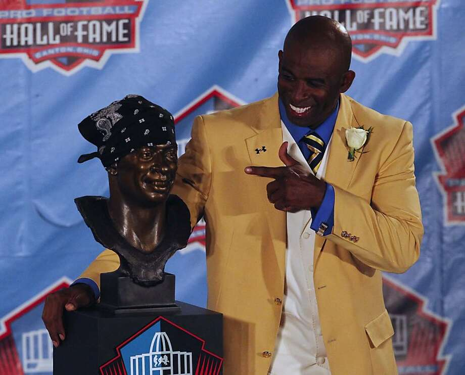 Enshrinee Deion Sanders poses with his scarf-adorned bust at the NFL's Hall of Fame Enshrinement Ceremony at Fawcett Stadium in Canton, Ohio, on Saturday, August 6, 2011. (Karen Schiely/Akron Beacon Journal/MCT) Photo: Karen Schiely, MCT