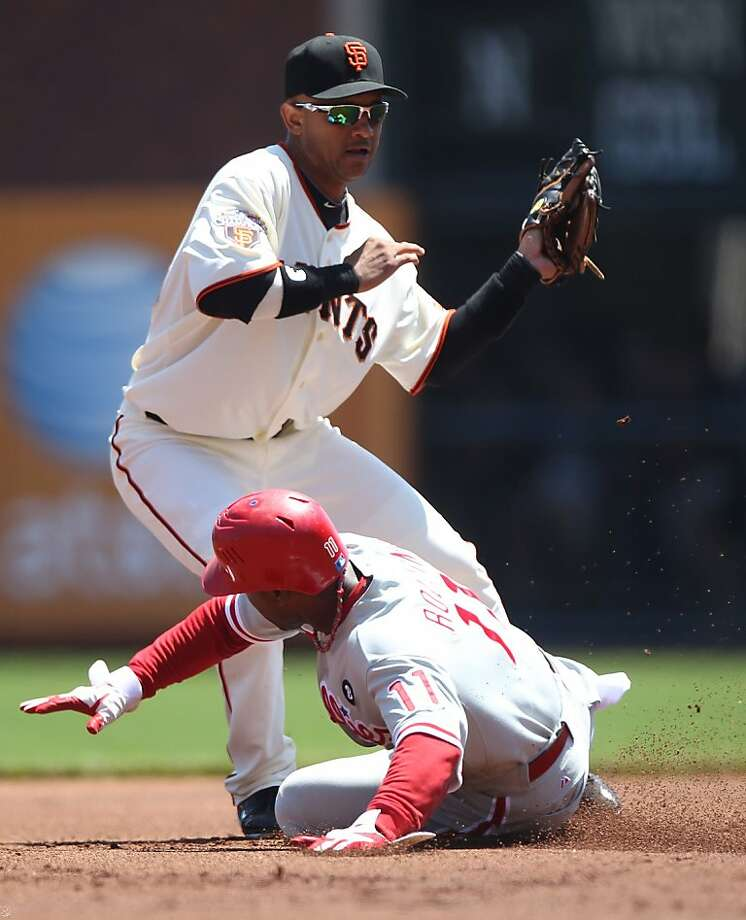 SAN FRANCISCO, CA - AUGUST 06:  Orlando Cabrera #43 of the San Francisco Giants fails to tag out Jimmy Rollins #11 of the Philadelphia Phillies on a pick off attempt in the first inning at AT&T Park on August 6, 2011 in San Francisco, California. Photo: Jed Jacobsohn, Getty Images
