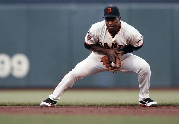 San Francisco Giants Miguel Tejada fields a ground ball by San Diego Padres Cameron Maybin during the second inning of a baseball game, Tuesday, July 5, 2011, in San Francisco. Tejada was playing second base for the first time as a Giant. Photo: Lance Iversen, The Chronicle