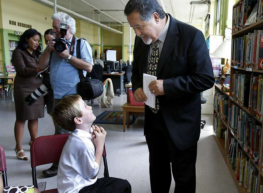 SFUSD Superintendent Carlos Garcia talked with seven year old Jackson Moran before the event.Educational leaders gathered at Leonard R. Flynn elementary school in San Francisco, Calif. Thursday August 11, 2011 to announce that for the fourth year in a row, San Francisco has reduced the number of habitually and chronically absent children enrolled in public schools. Photo: Brant Ward, The Chronicle