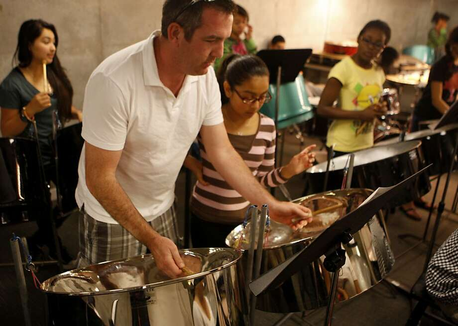 Teacher Joe Kelly, 37, helps Abigail Serrano, 14, during her steel drum class on Monday, July 25, 2011 in Richmond, Calif., at the East Bay Center for the Performing Arts. The center provides classes to thousands low-income kids and has just undergone a major $16 million renovation. Photo: Michelle Terris, The Chronicle