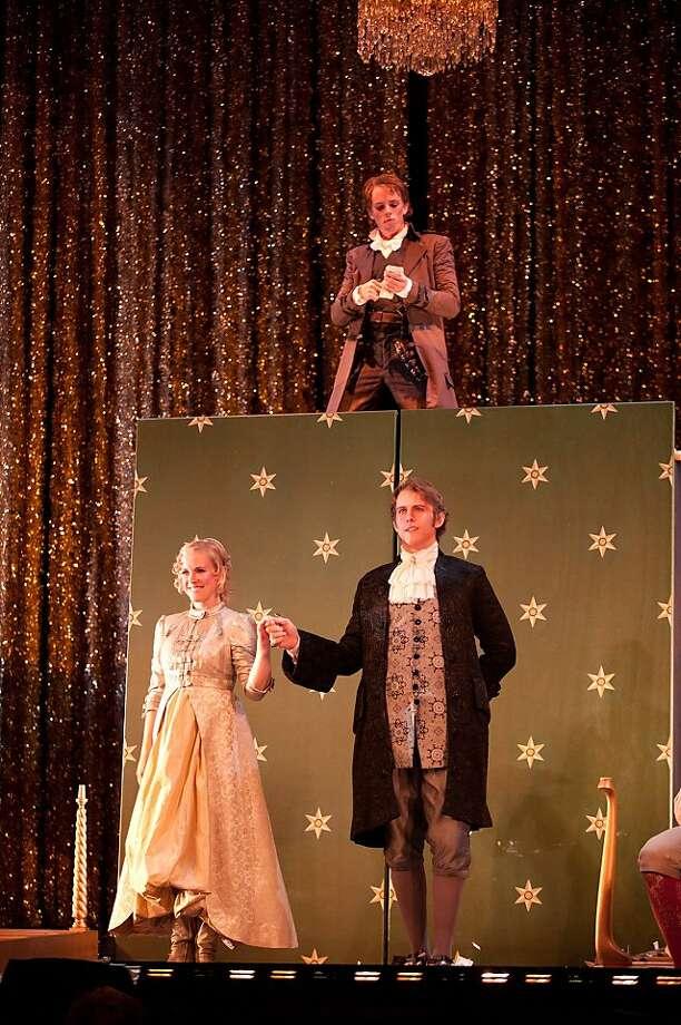"Jonathan Michie (top) as Figaro, Suzanne Rigden as Rosina and Heath Huberg as Count Almaviva in Rossini's ""Barber of Seville"" at Merola Opera Program Photo: Kristen Loken"