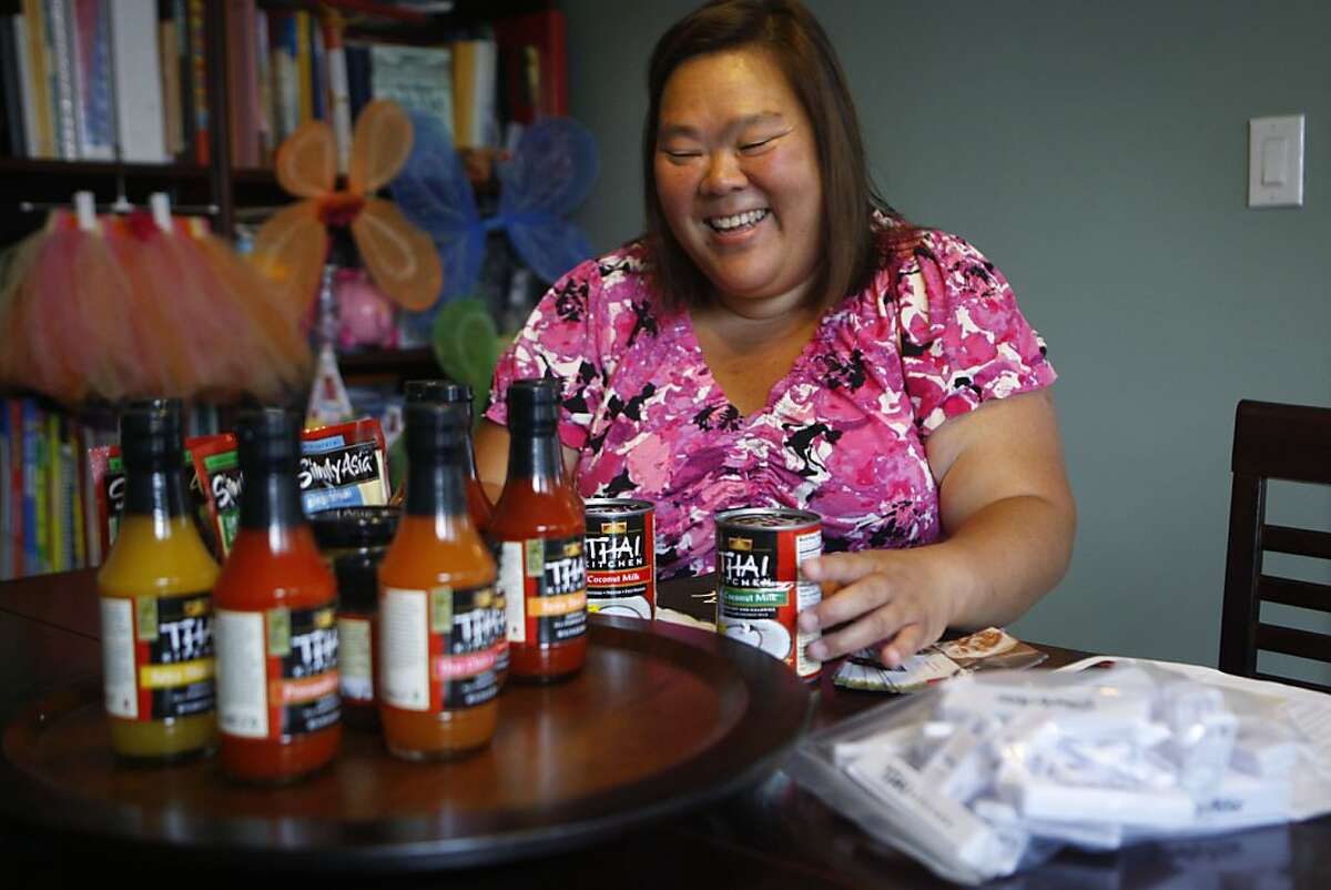 Mimi Jiggins looks through her House Party Thai Kitchen package in San Francisco Calif., on August 2, 2011.