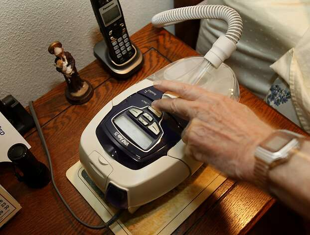The CPAP machine sits on a vanity beside the bed. Les Besser, 75, suffers from sleep apnea in Los Altos, Calif.  He runs a sleep apnea support group and uses a CPAP machine to get through the night. Photo: Brant Ward, The Chronicle