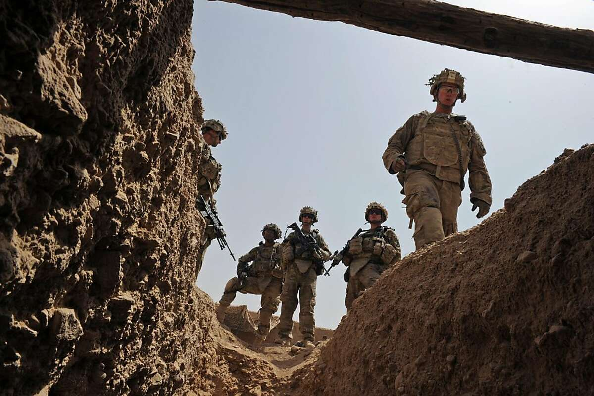 Fresh US troops from the 3rd Platoon, Charlie Company, 2-87 Infantry, 3rd Brigade Combat Team arrive at a patrol base on the outskirts of Kandalay village in southern Kandahar province on August 7, 2011. There are currently around 140,000 foreign soldiers in Afghanistan, with about 100,000 of them from the US. All international combat troops are due to leave by the end of 2014, but intense violence in recent months has raised questions over the prospects for Afghan forces as they take over. AFP PHOTO / ROMEO GACAD (Photo credit should read ROMEO GACAD/AFP/Getty Images)
