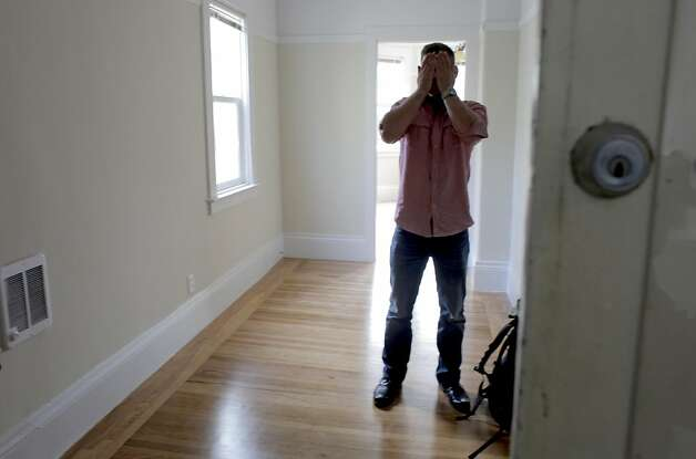 "Jeff Leininger wipes his face after looking at a junior one bedroom apartment on Webster street for $1,895., Wednesday August 10, 2011, in San Francisco, Calif. "" So this is what $1,900 gets you in the city,"" says Leininger. Photo: Lacy Atkins, The Chronicle"