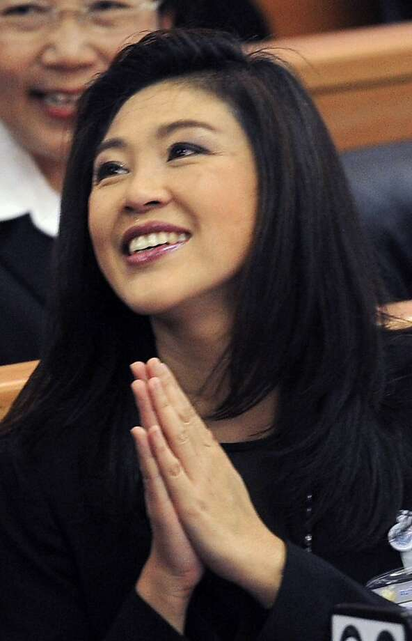 Yingluck Shinawatra gives a tradition greeting to members of parliament as she is confirmed in a vote as the new Thai prime minister in Bangkok on August 5, 2011. Yingluck became politically turbulent Thailand's first female prime minister after parliament endorsed her crushing election victory. Photo: Pornchai Kittiwongsakul, AFP/Getty Images